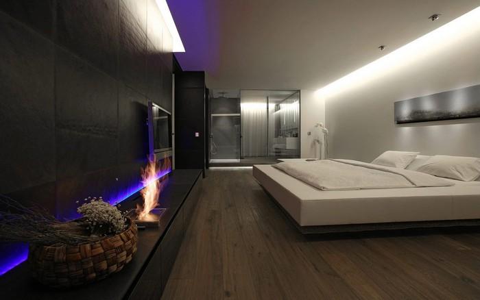 спальня с биокамином в стиле минимализм