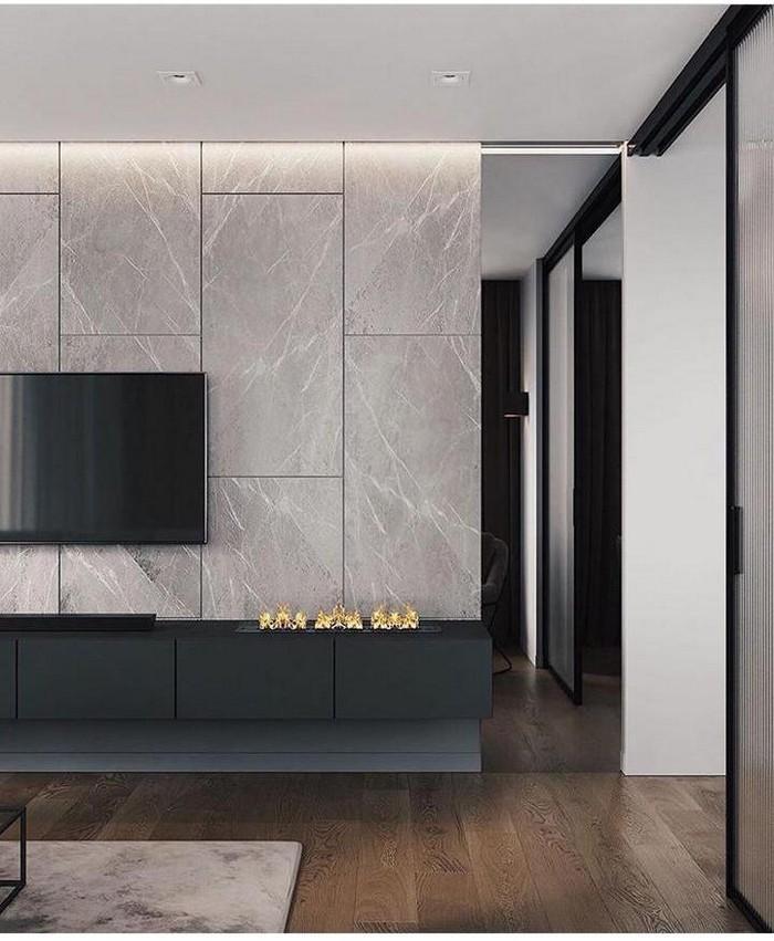 бетонные панели в оформлении стены с биокамином